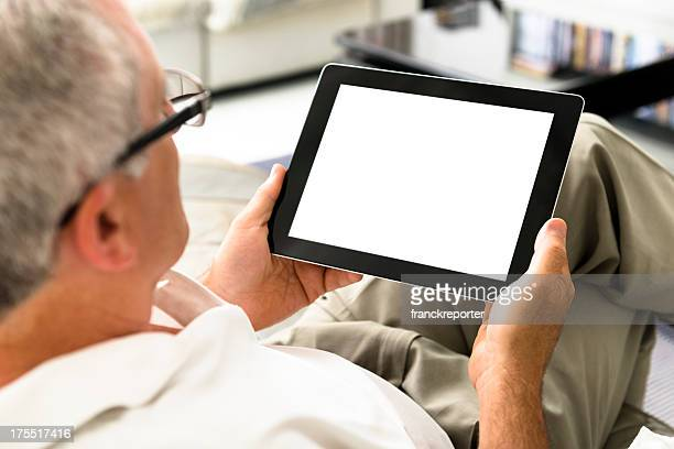 Human hand holding black digital tablet with blank screen