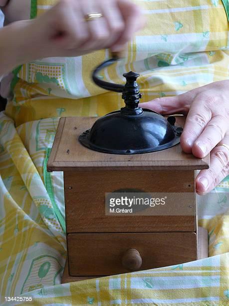 Human hand holding coffee grinder