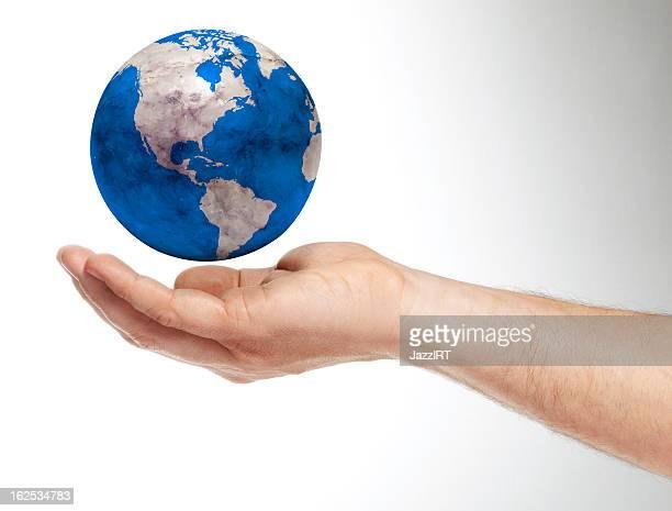 Mão Humana segurando a Terra