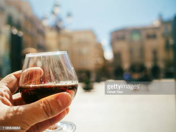 human hand holding glass of cognac - reus spain ストックフォトと画像