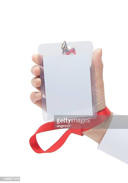 human hand holding Name Tag
