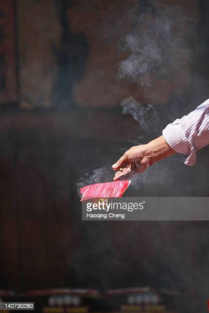 human hand lighting firecrakers - fuzhou stock pictures, royalty-free photos & images