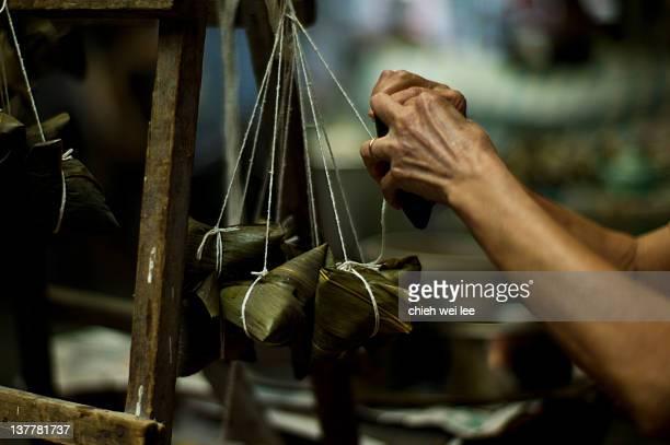 Human hand making rice dumplings