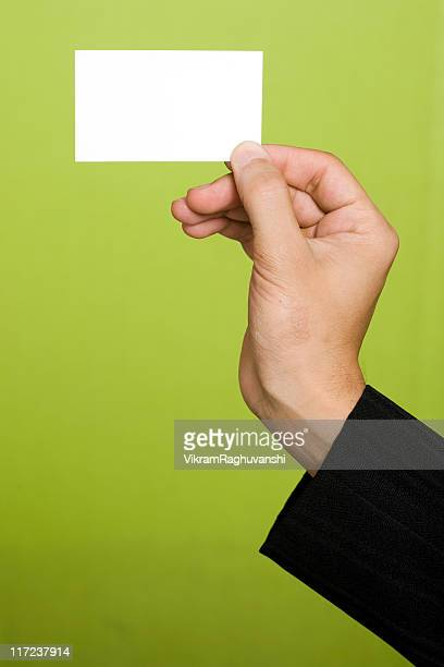 Human Hand of Businessman Holding a Blank business card Placard