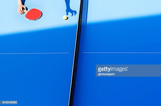 Human hand on tennis table