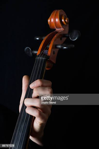 Human hand playing a cello