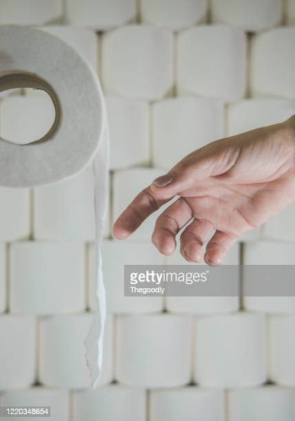 human hand reaching for toilet roll - unknown gender stock pictures, royalty-free photos & images