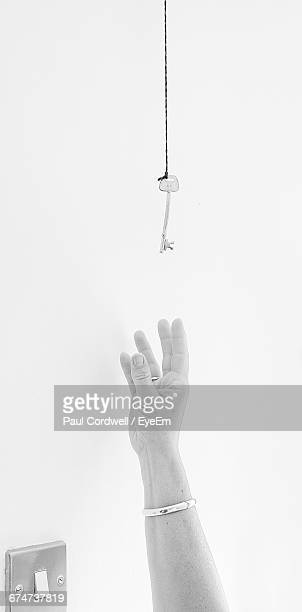 Human Hand Reaching Out For Key