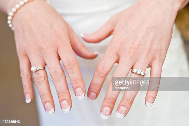 human hand showcasing two beautiful elegant wedding rings - community engagement stock pictures, royalty-free photos & images