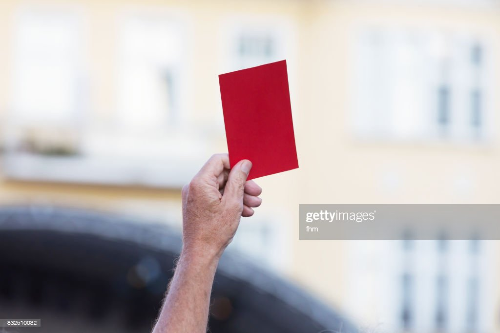 Human hand, showing red card : Stock Photo