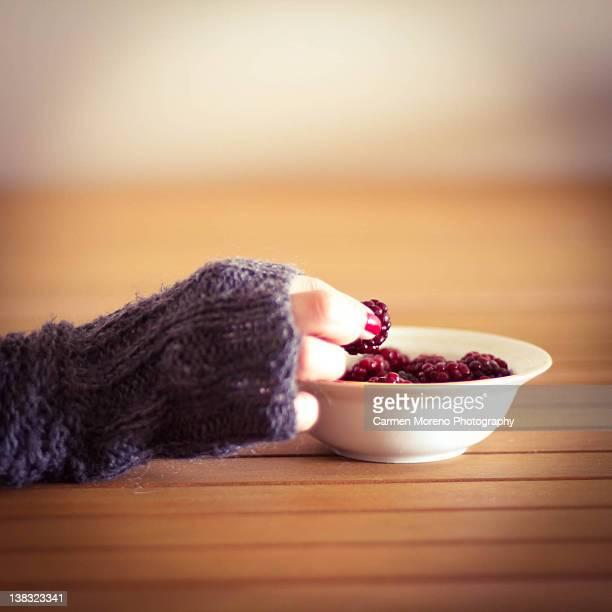 human hand taking strawberry - 指なし手袋 ストックフォトと画像