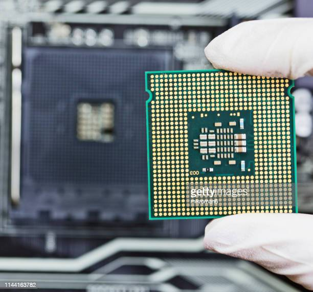 human hand to installing integrated circuit, cpu - cpu stock pictures, royalty-free photos & images