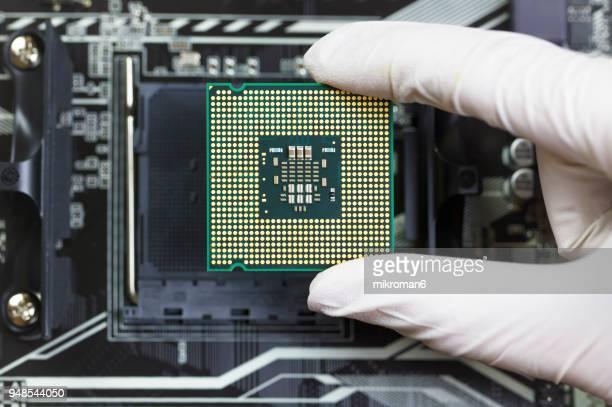 Human hand to installing integrated circuit, CPU