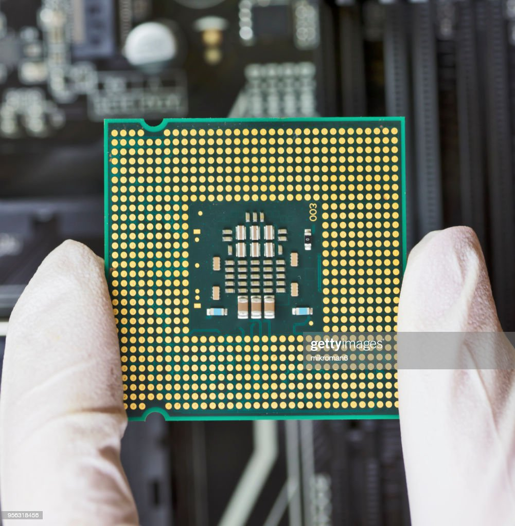 Human Hand To Installing Integrated Circuit Cpu Stock Photo Getty Where Buy Circuits