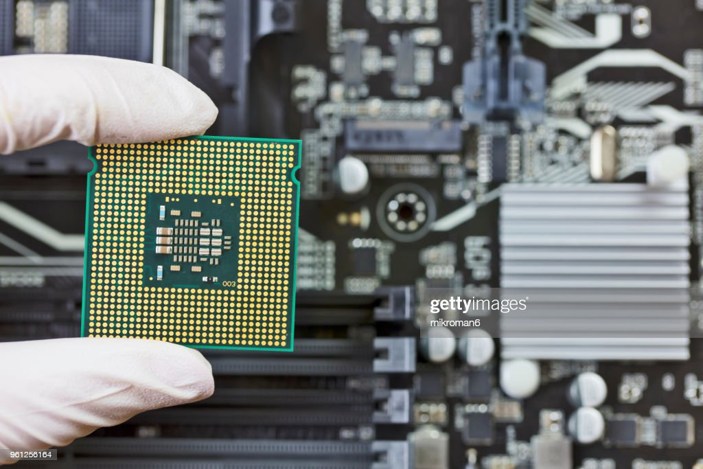 Human hand to installing integrated circuit, CPU : Stock Photo