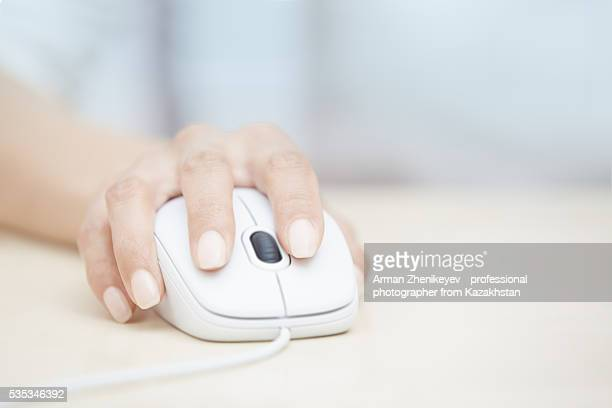 Human hand using computer mouth