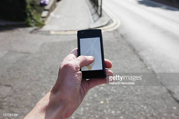 Human hand using GPRS map navigation on cell