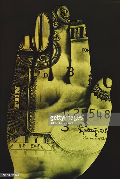 A human hand with a 10 dollar bill superimposed on it circa 1985