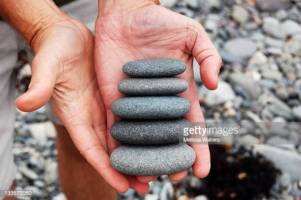 human hand with stones in hand - lubec stock photos and pictures