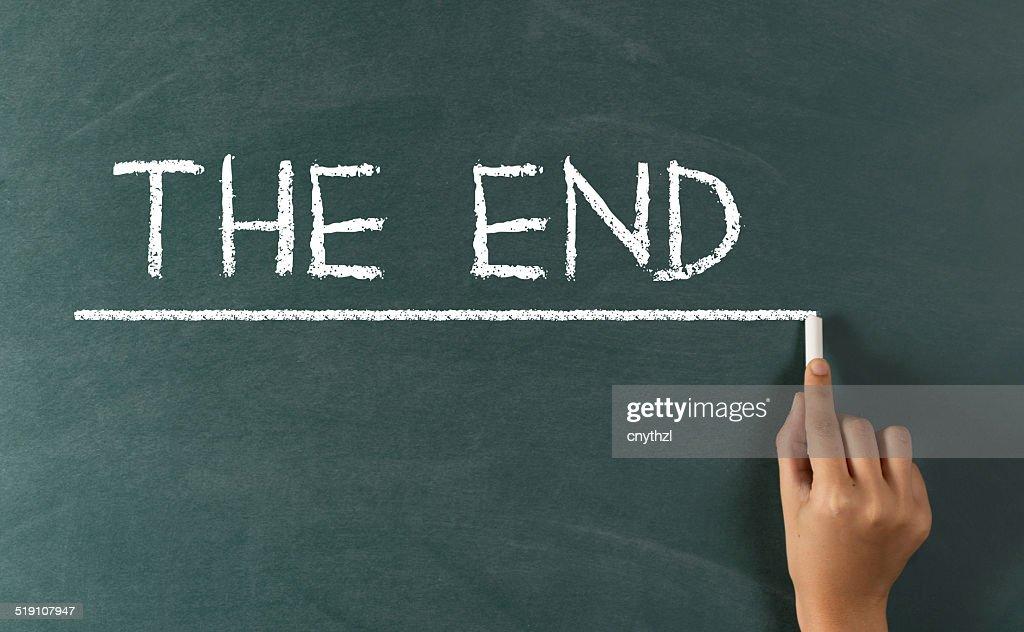 Human Hand Writing The End On Blackboard Photos Com