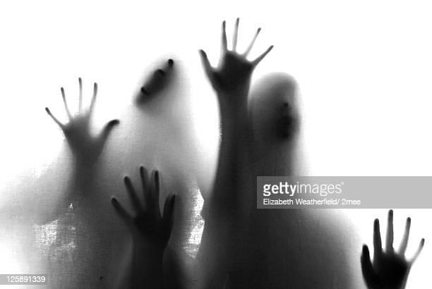Human hands behind glass