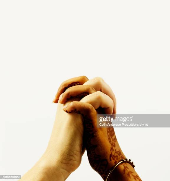 Human hands clasped together