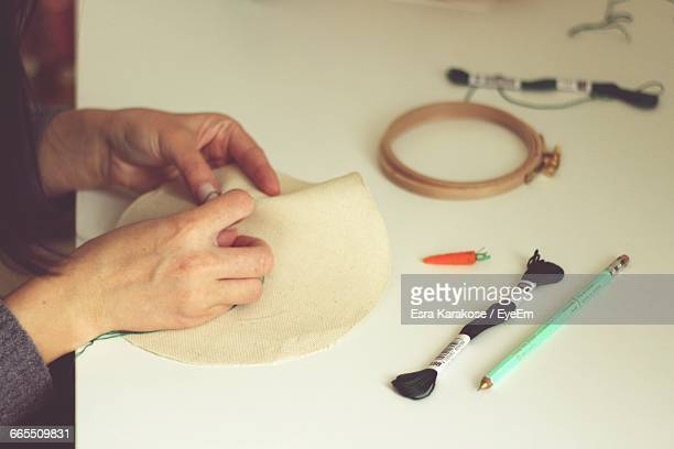 Human Hands Embroidering Cloth