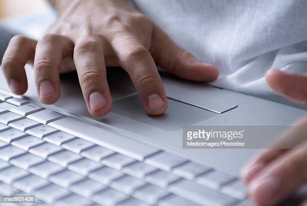 Human Hands operating a Laptop