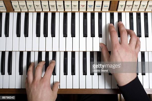 Human hands playing a organ