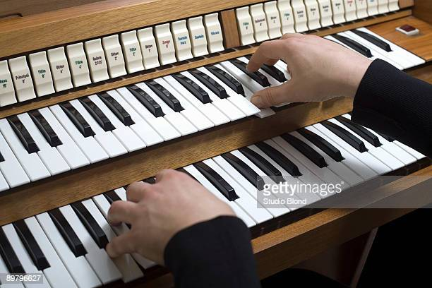 human hands playing a organ - church organ stock pictures, royalty-free photos & images