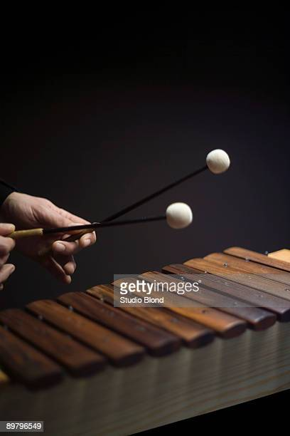 human hands playing a xylophone - entertainment occupation stock pictures, royalty-free photos & images