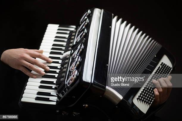 Human hands playing an accordion
