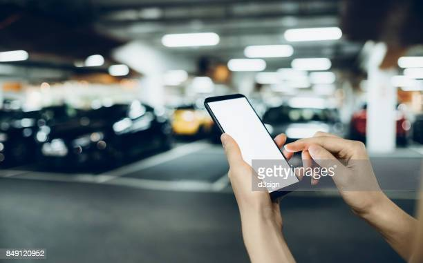 Human hands using cell phone while in rush