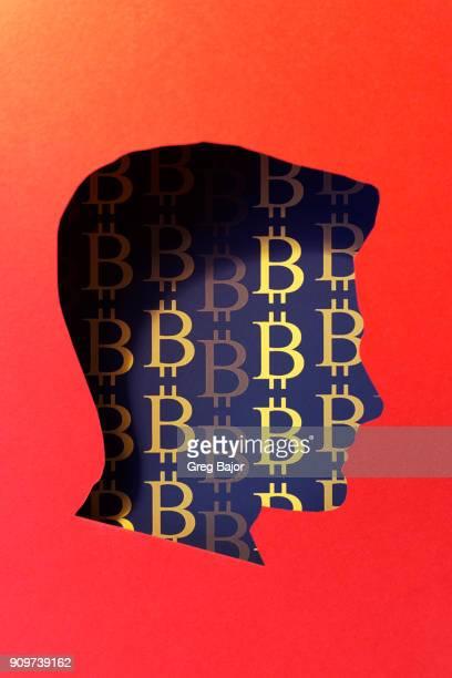 Human head and Bitcoin signs