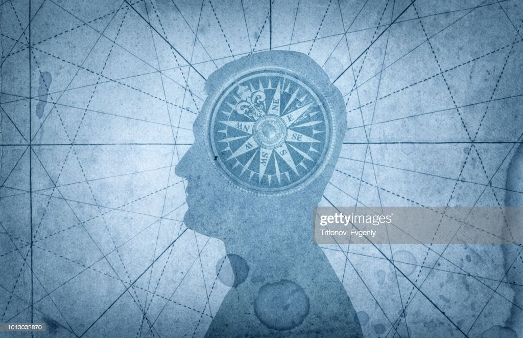 Human head and compass. : Stock Photo