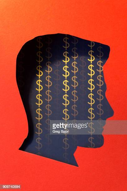 Human head and dollar signs