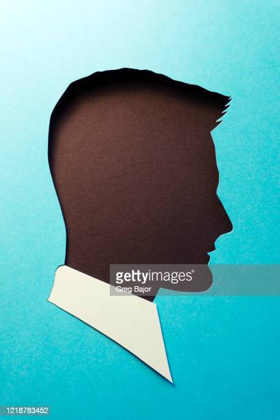 human head and plain dark background - greg bajor stock pictures, royalty-free photos & images