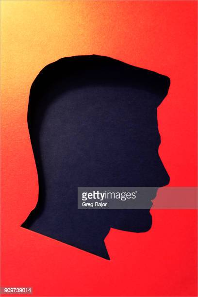 Human head and plain dark background