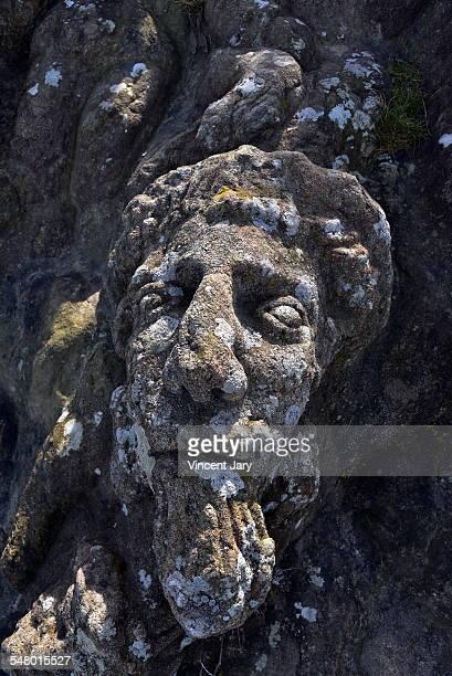 Human head sculpture on rock Saint Malo