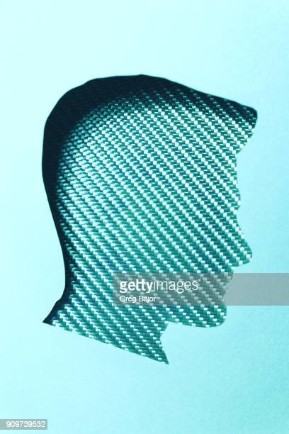 Human head with carbon fibre background