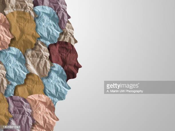 human heads made with crumpled  paper in different colors on a white background - social movement stock pictures, royalty-free photos & images