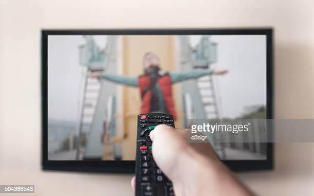 Human holding remote control with soap channel