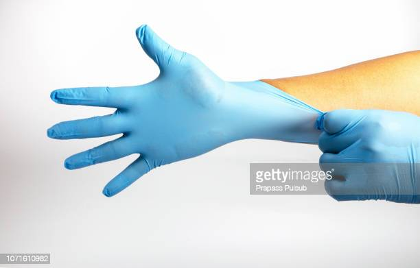 human holding variation of latex glove, rubber glove manufacturing, human hand is wearing a medical glove, glove, isolated - luva vestuário para proteção imagens e fotografias de stock