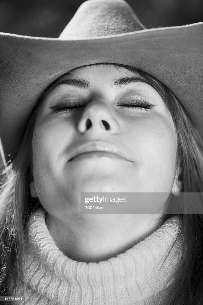 c3958709991 Human in Nature  CowGirl amp Ten-Gallon Hat   Stock Photo