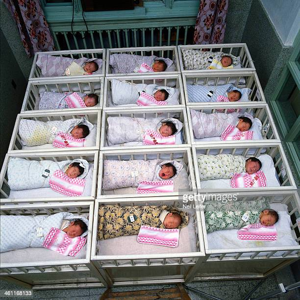 View of newborn children in cribs at a hospital nursery Beijing China 12/1/1985 CREDIT Neil Leifer