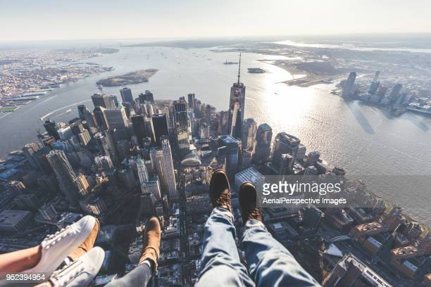 pov of human leg against downtown manhattan / nyc - helicopter photos stock pictures, royalty-free photos & images