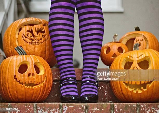 Human legs in stockings near hallow eve