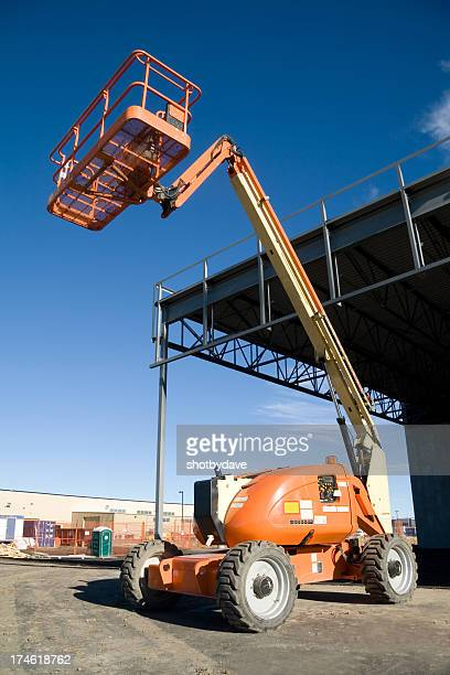 human lift - crane construction machinery stock pictures, royalty-free photos & images