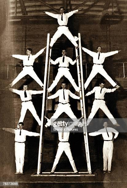 human pyramid - human pyramid stock photos and pictures