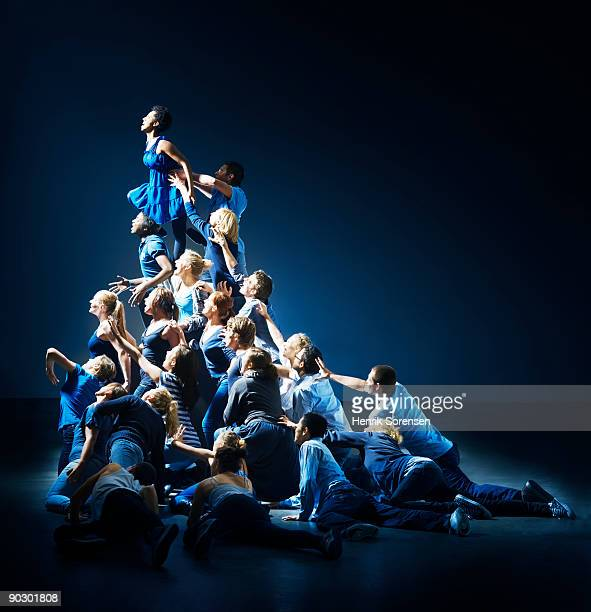 human pyramid - pyramid stock pictures, royalty-free photos & images